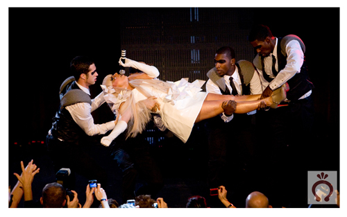 How many masked gays does it take to lift little Gaga?