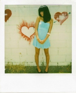 polaroid - girl in front of wall