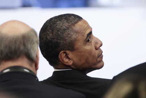 Obama looking behind him