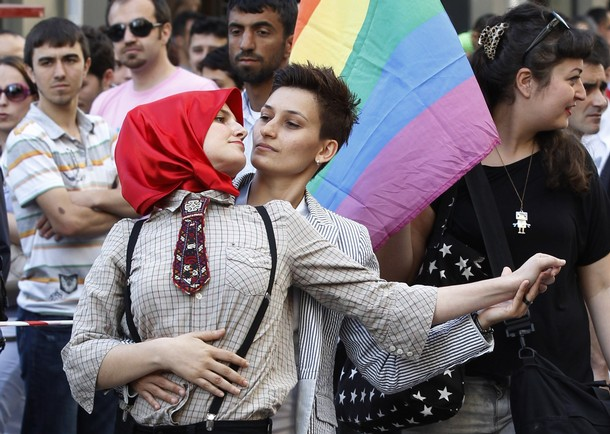 Participants dance during a gay pride parade in central Istanbul