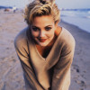 March 1993 --- Drew Barrymore on a Beach --- Image by © Jeffrey Thurnher/CORBIS OUTLINE