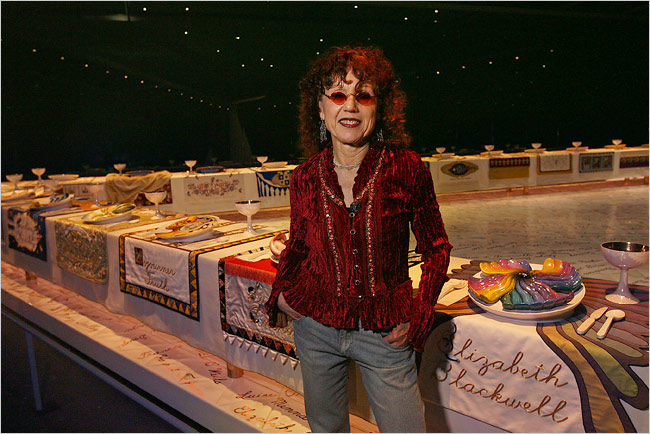 Judy-Chicago-in-front-of-her-sculpture-The-Dinner-Paty1