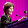 Former First Lady Laura Bush with bobble headed likeness during the Women's Conference on Tuesday.