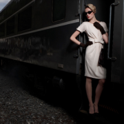 woman on train_vintage feel black_Greg Sorensen photographer_Kate Ryan Inc
