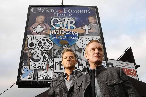 Gay radio hosts turn vandalized ad into positive statement