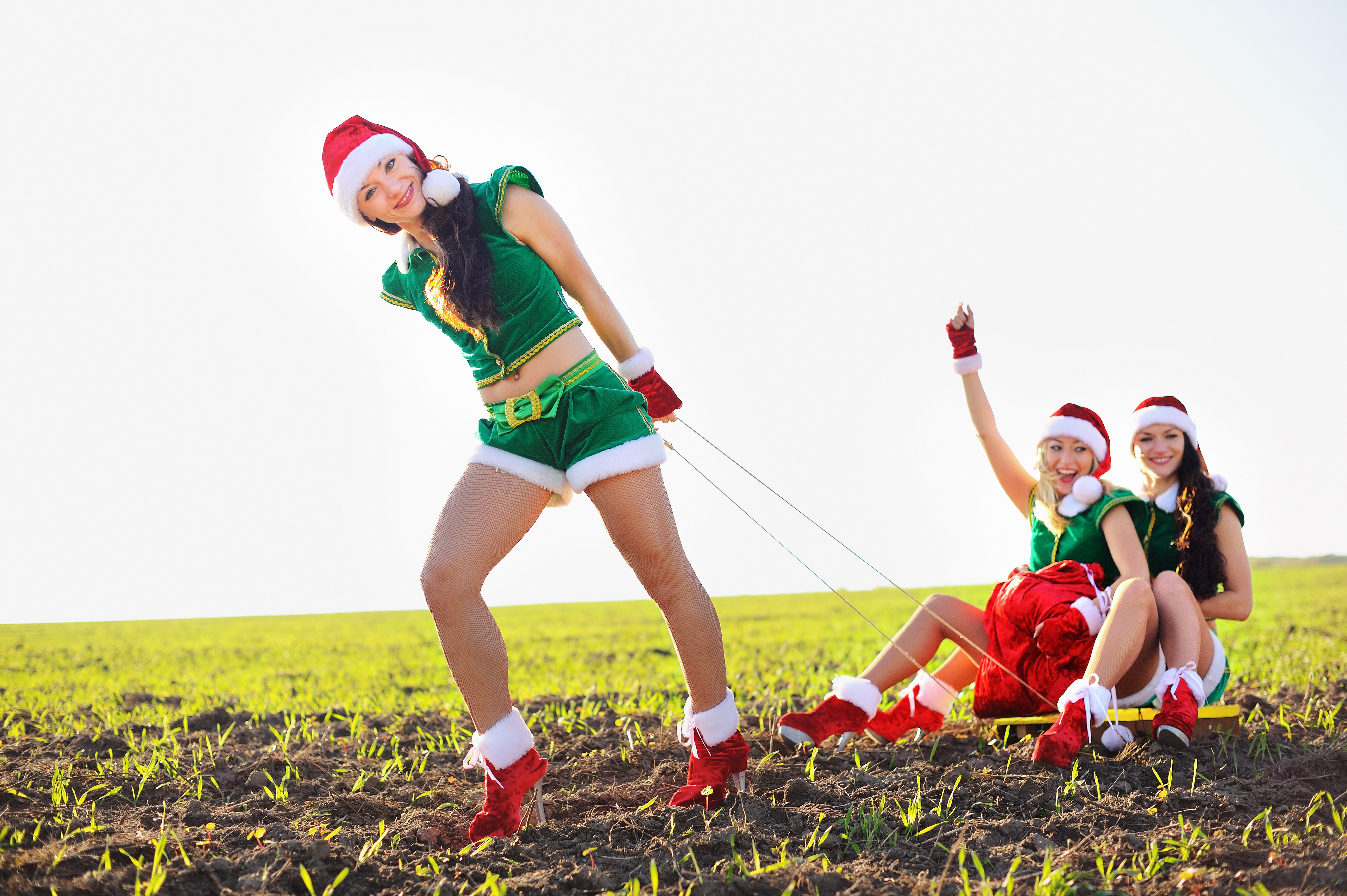 young girls wearing santa claus clothes