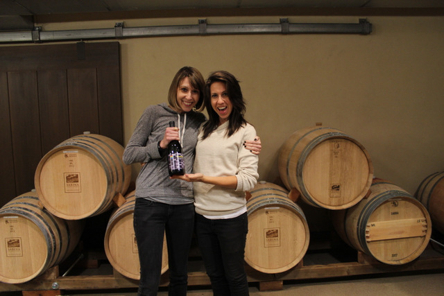 me and Autostraddle.com co-founder Alexandra Vega with a bottle of wine