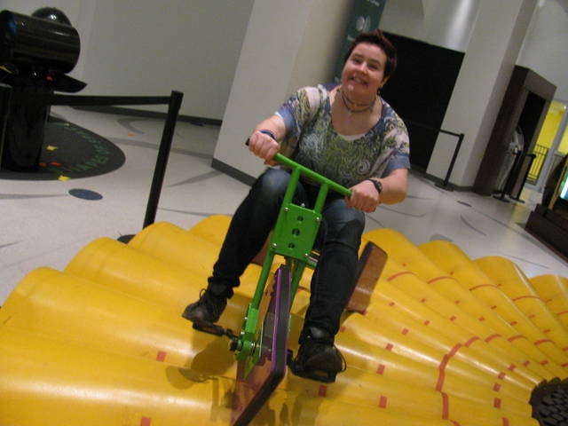 Me at the Museum of Mathematics in Manhattan. The tricycle has square wheels with the same side lengths as the arcs on the platform, so you can ride itÑit's really cool.