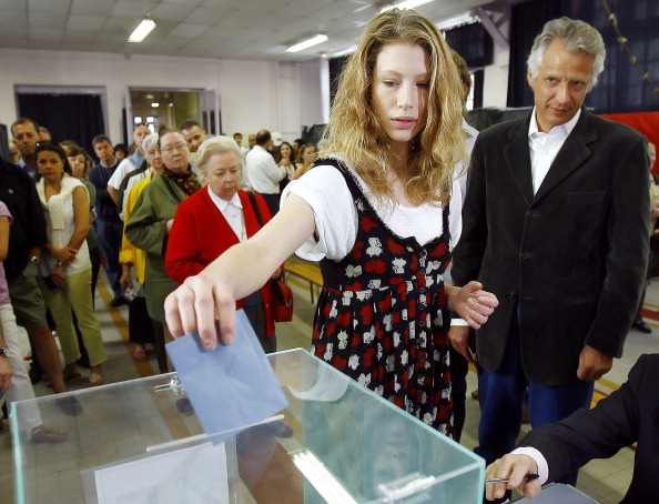 """French Prime Minister Dominique De Villepin (R) watches his daughter Marie casting her vote, 22 April 2007 in Paris for the first round of the French presidential election."" (FRANCK FIFE/AFP/Getty Images)"