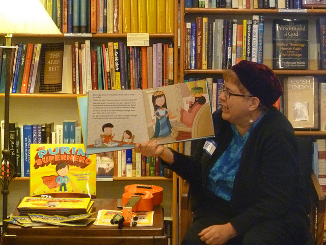 Author Elisabeth Kushner reading her book, The Purim Superhero, at a launch party at Afikomen Judaica in the Bay Area via Keshet