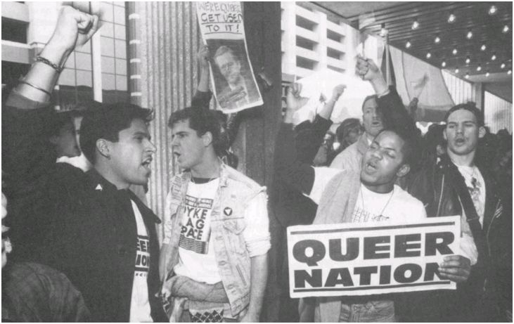 A QUEER NATION PROTEST, FEATURING THE FAMOUS SLOGAN