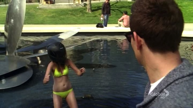 only moments later, this girl will fall backwards into that pool and then feel really happy about wearing a helmet