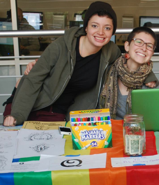 Maddy with her friend Chris (left) tabling for Q.