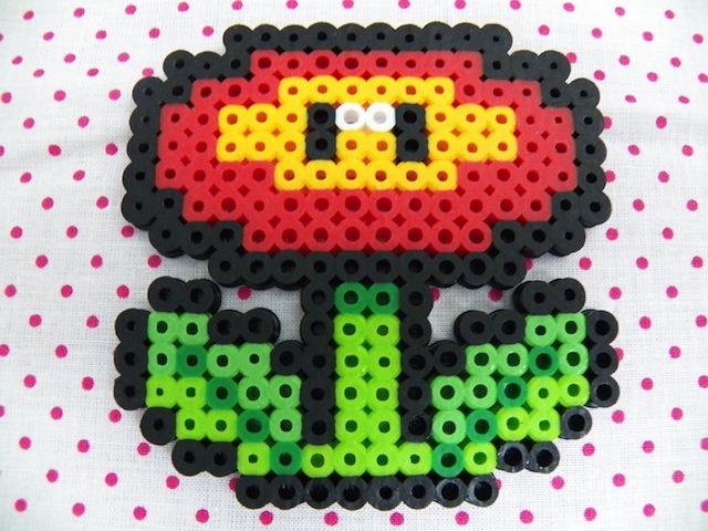 Beady little fire-ball-throwing eyes. via etsy.com