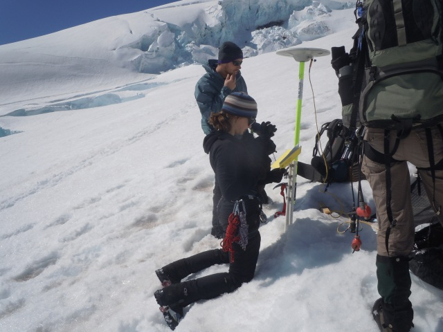Me installing a seismometer (instrument to measure earthquake activity) on Mt. Rainier, with my all male field team.