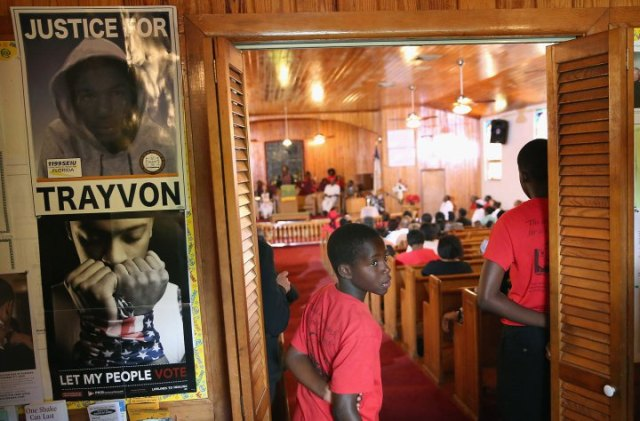 """""""Parishioners attend Sunday service at Allen Chapel AME church in the historic black neighborhood of Goldsboro on July 14, 2013 in Sanford, Fla.""""  (Photo by Scott Olson/Getty Images)"""