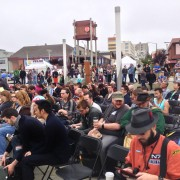 An eager crowd awaits the opening ceremonies.