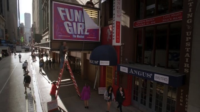 rachel had selected her magenta coat because it matched the shade of her favorite JimmyJane personal vibe, but was pleased to discover its complementary tones also matched the Funny Girl sign