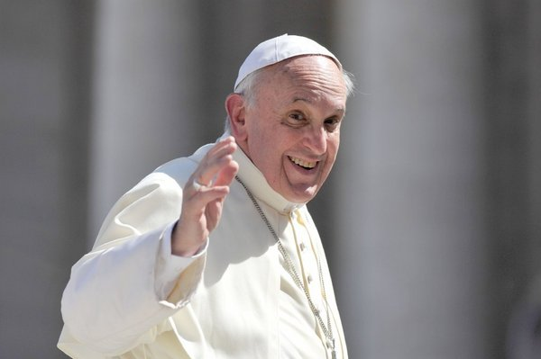 Pope Francis waving and looking friendly