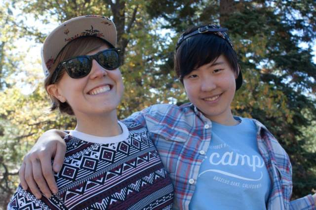 Hannah and Hannah in matching floral print hats at A-Camp in October, 2013.