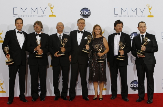 """Alex Gansa (C) and fellow writers pose with their award for outstanding writing for a drama series for ""Homeland,"" backstage at the 64th Primetime Emmy Awards in Los Angeles, September 23, 2012. (Photo : Reuters)"""