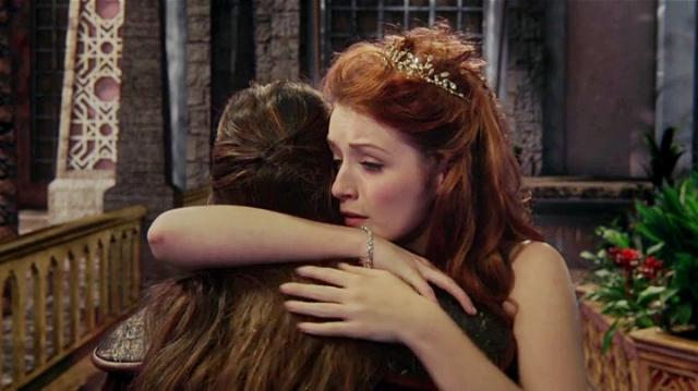 Aurora is distraught as she hugs Mulan.