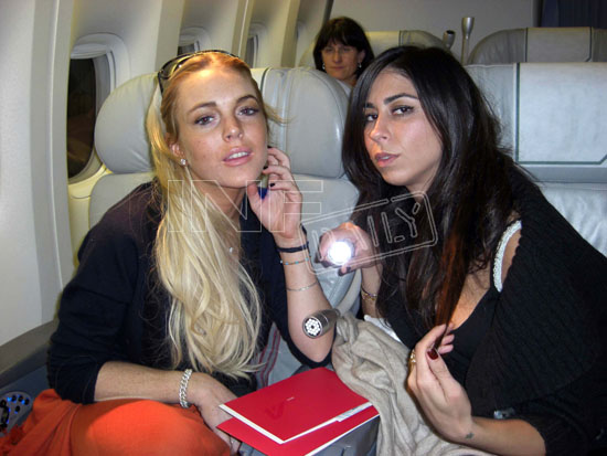 Exclusive - Lindsay Lohan & Courtenay Semel Get Cozy on Flight to Capri