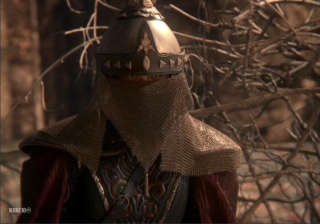 A helmeted warrior. Their face is covered.