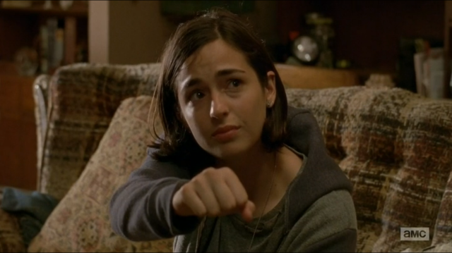 Tara holds her fist out.