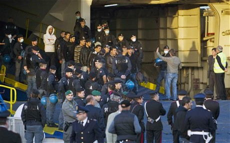 Tunisian refugees disembark at the port of Civitavecchia, near Rome via The Telegraph