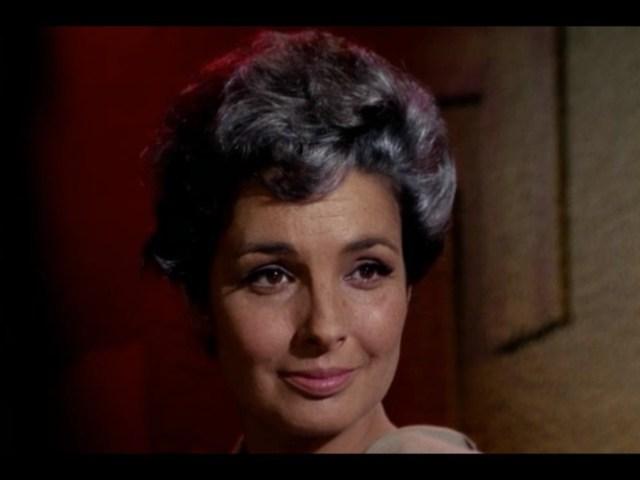 Kirk: She's an unassuming older archeologist!