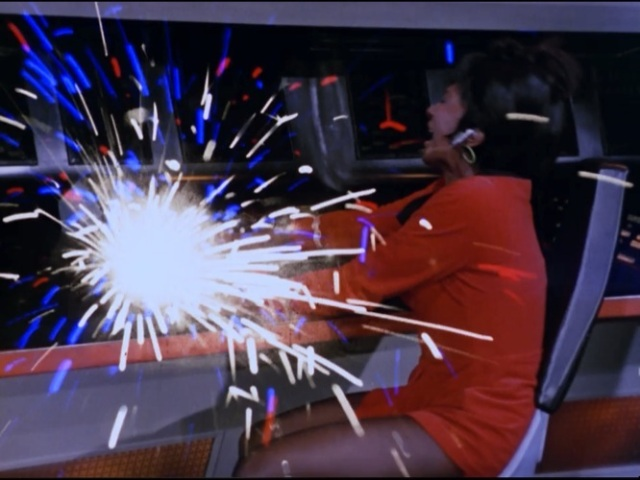 Charlie seizing the ship and shocking Uhura away from her controls.