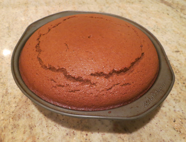 After! (Don't worry about the cracks – when you flip the cake over to get it out of the pan you'll be frosting the BOTTOM so the top literally does not matter at all YAY!)