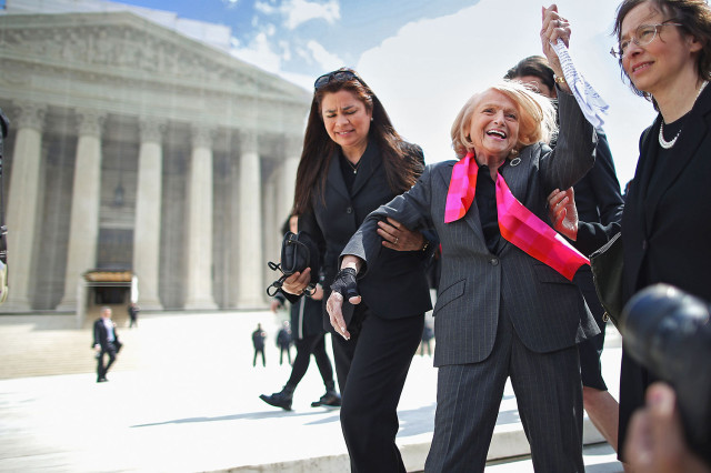 WASHINGTON, DC - MARCH 27: Edith Windsor (C), 83, acknowledges her supporters as she leaves the Supreme Court March 27, 2013 in Washington, DC. The Supreme Court heard oral arguments in the case 'Edith Schlain Windsor, in Her Capacity as Executor of the Estate of Thea Clara Spyer, Petitioner v. United States,' which challenges the constitutionality of the Defense of Marriage Act (DOMA), the second case about same-sex marriage this week. (Photo by Chip Somodevilla/Getty Images)