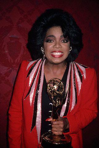 Oprah Winfrey Holding an Emmy Award
