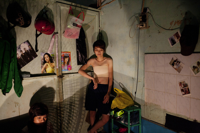 Nguyen Thi Kim Ngan and Dam Ngoc Hoang watch a horror movie in their apartment in Ho Chi Minh City