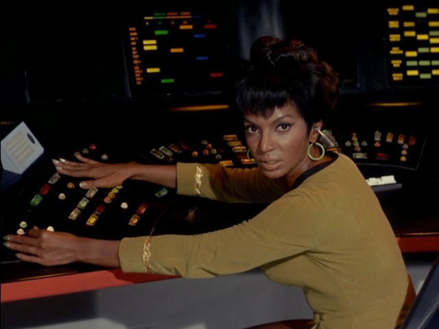 Check out those earrings! And that Bluetooth headset! Uhura's always stylin'.