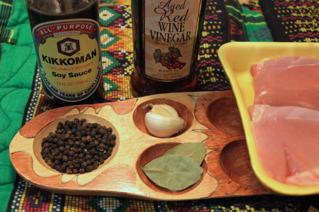 Adobo ingredients: peppercorns, garlic, bay leaves, soy sauce, red wine vinegar.