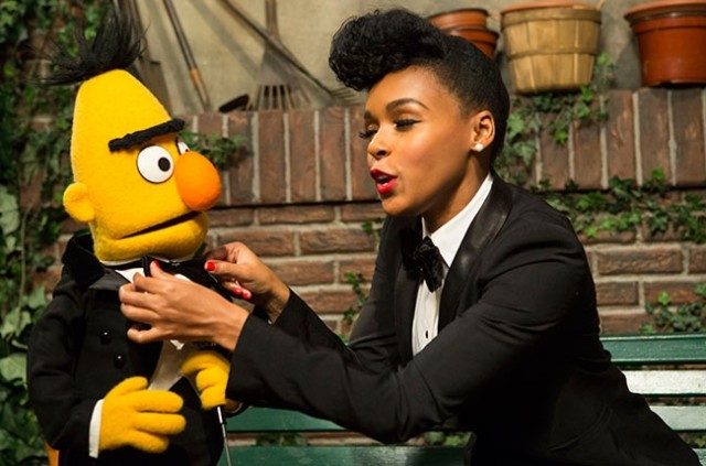 Janelle Monáe teaches Bert how to tie a bowtie.