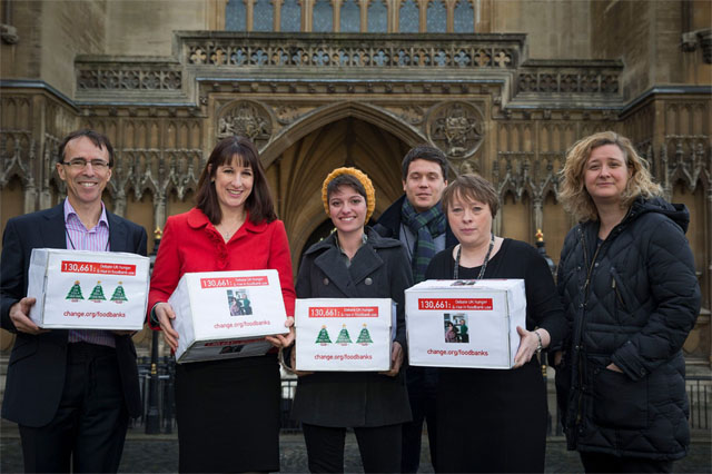Jack Monroe (centre, in yellow hat) with food bank petition boxes via The Mirror