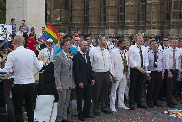 Celebrations outside Westminster Parliament as the marriage bill passed its Third Reading via Wikimedia Commons