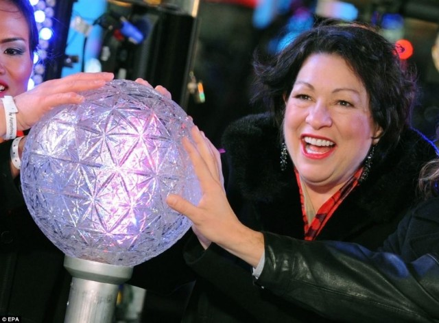 Justice Sonia Sotomayor prepares to push the Waterford crystal button that signals the descent of the New Year's Eve Ball. Via Daily Mail.