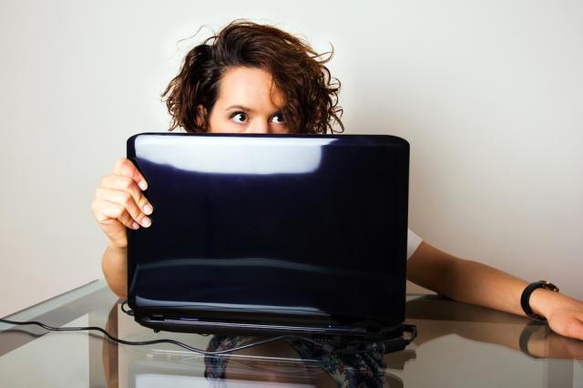 One eye on the screen, one eye on the door. via Shutterstock