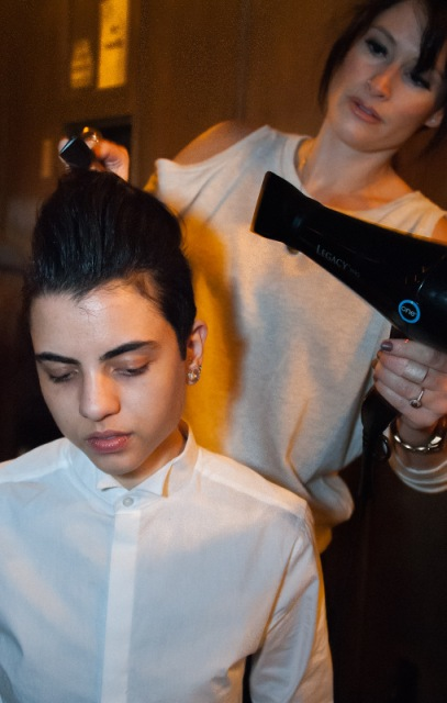 Chris Konnaris' hair is styled backstage. Copyright Joi Ong.