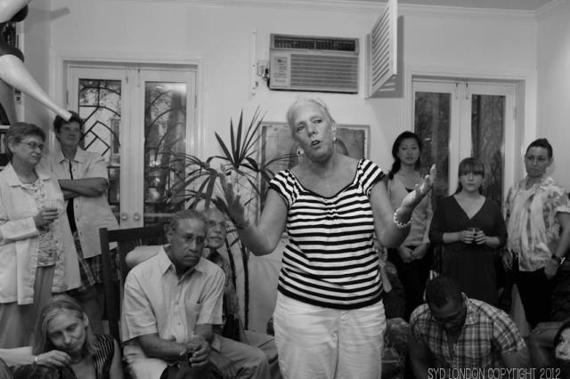Hollibaugh speaks at a QEJ gathering. via Syd London and QEJ Facebook