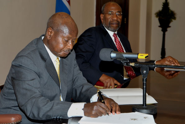 President Museveni signs the Anti-Homosexuality Bill into law on Feb. 24th, 2014 via Daily Monitor