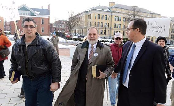 Scott Lively, center, enters U.S. District Court in Jan. 2013,  when first sued by Ugandan activists for his hateful speech via Slate