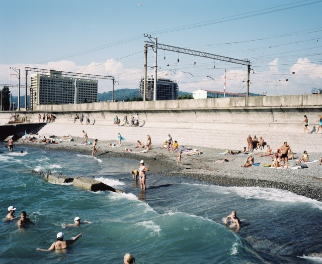 The Railway line passes by a pebble beach popular with Russian tourists. (Rob Hornstra/Flatland Gallery. All images from The Sochi Project: An Atlas of War and Tourism in the Caucasus (Aperture, 2013).)