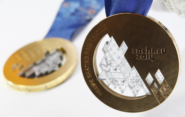 The gold and bronze medals manufactured for the 2014 Winter Olympic Games in Sochi are seen on display at the Adamas jewellery factory in Moscow