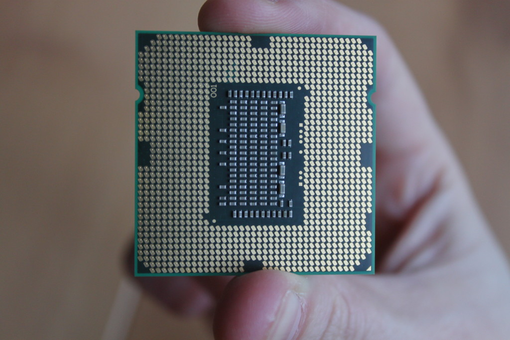 The underside of an intel i5 processor, ribbed for your pleasure.